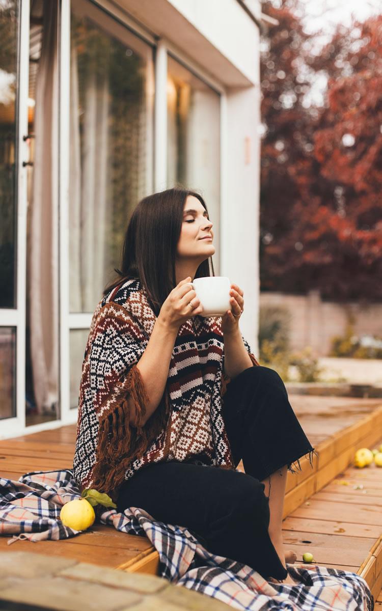 woman enjoying calming tea