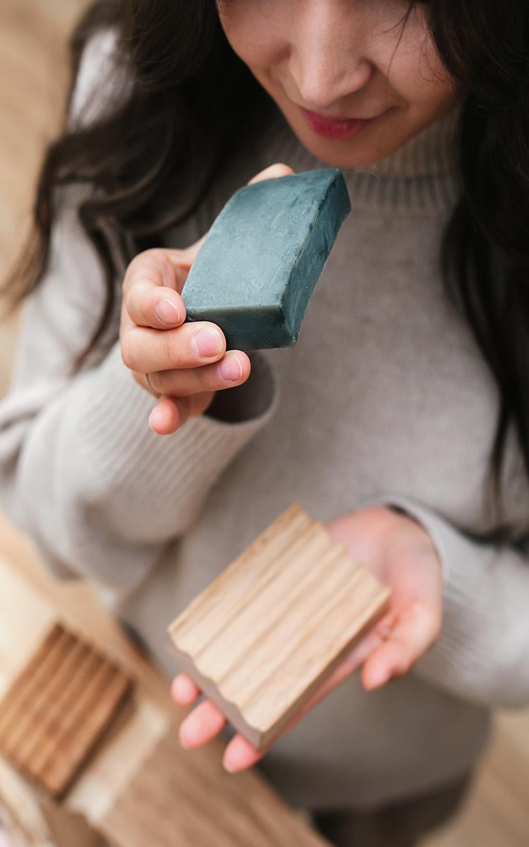 woman smelling tea tree soap