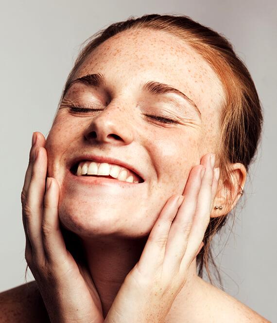 happy woman after a rhinoplasty